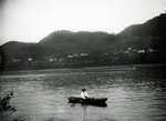 Photograph - Man in Boat across from Indian Head Rock