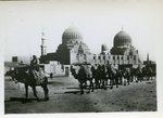 Camel train leaving town